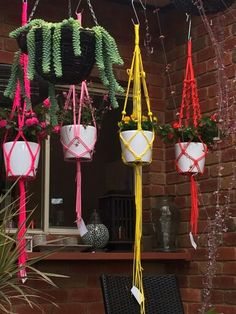 Some colourful macrame hanging baskets made with super strong paracord.