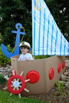 Nautical birthday party photo booth idea! Build a cardboard boat with paper plate windows, a sheet for a sail and a prop captain's hat. Memories for years!