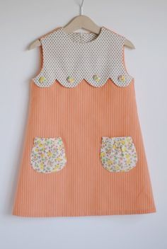 Sweetest Dress with scallop + floral pockets. DIY for an existing tee/dress? Imagine with ivory lace at the top ovory tulle and cotton behind it with lace pokects Girl Dress Patterns, Clothing Patterns, Sewing Patterns, Skirt Patterns, Coat Patterns, Blouse Patterns, Little Dresses, Little Girl Dresses, Sewing For Kids