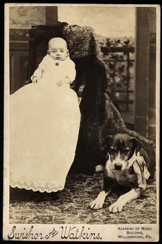 Child in giant dress with dog by her (?) side