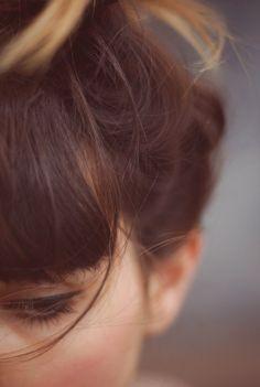 messy hair bun + fringe..