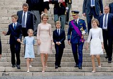 The 43-year-old monarch beamed as she arrived at the 'Te Deum' mass at the Cathedral of St. Michael and St. Gudula in Brussels with her well-dressed family