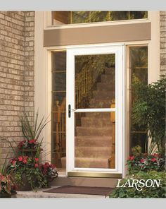 This Beautiful Entry Gets Its Impact From The White Screen Away Storm Door  With Retractable Screen