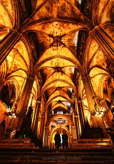 The inside of the Cathedral La Seu, Barcelona features many wonderful stained glass, arched ceilings, carvings, paintings & sculptures