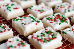 Christmas cookies for the lazy: don't have to chill the dough, roll it , cut it, or decorate individual cookies. Just spread in a pan and frost them all at once. Cut into squares.