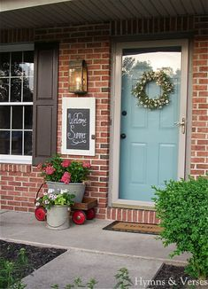 Brick wall + light blue door + grayish trim + storm door. via Debbiedoo's.