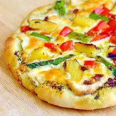 Grilled Asparagus Pineapple and Chicken Pizza This pizza was inspired by the Primary Colors pizza at a local restaurant, Pi, on King's Road here in St. John's. Good thin crust pizza is hard, if not impossible to come by in this neck of the woods and these guys are the best of what's available here. …
