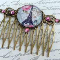This lovely hair comb is made of bronze metal. In the center I placed a simple setting with handcrafted glass cabochon. The cabochon shows a beautiful  Paris motif with Eiffel Tower and roses. The eye of the frame and the sides of the comb are decorated with pink Swarovski rhinestones.   The ha...