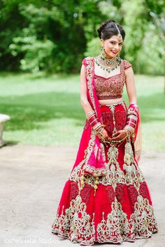 This Indian bride poses for beautiful portraits in a stunning red lengha.