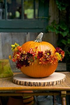 Using floral water vials pushed into the pumpkin's side makes this floral border as easy as pumpkin pie! Notes from the Field: Pumpkins Go Beyond Halloween | New England Home Magazine