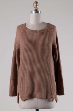 - Classic chunky knit sweater - Round neckline - Long sleeves - Side slits - Loose fitting - 55% Cotton 45% Acrylic - Imported