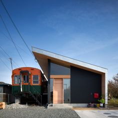 An old railway carriage forms one half of this family home in Takasago City, Japan, while the other half looks like it could be a railway station
