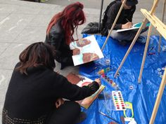 People hard at work painting what they interpret as a second chance of life