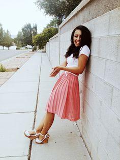 Pleated skirt, apricot. White shirt.