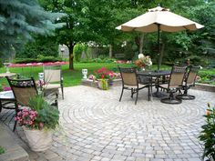 After: The small patio has been expanded, resurfaced and transformed into a comfortable outdoor living space. Design by HGTV fan Donna1943.