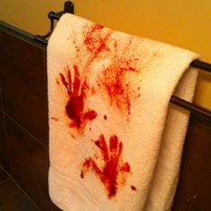 DIY Bloody Halloween Towel. One of the most effective and scary Halloween projects Ive seen. From Pinterest here.I know I bitch and moan about Pinterest not being a source but this was taken by an iphone and I have searched high and low for a source (and I wanted to work as a detective when I was very young) and there is none. Anyway, paint on hands then put them on towel and smear.