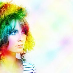 Colorful Abstract Design Of A Beautiful Young Woman With Colourful Wavy Hairstyle Standing In A Vibrant Rainbow Of Magic Colours by Ryan Jorgensen