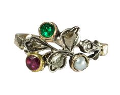 Antique giardinetti ring set with ruby, emerald, pearl and rose cut diamonds. The diamonds are set in silver, with the rest of the ring modelled in yellow gold.