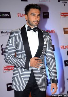 Hot! Ranveer Singh styles up in a Tom Ford suit while showing off his new hairstyle. via Voompla.com