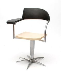 Barber chair Techno adjustable metal feet with plastic back- and armrest which metal extendible ashtray design Philippe Starck 1989 for Presence Paris / L'Oreal