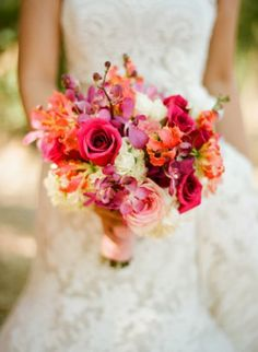 Bright and colorful bridal bouquet with shades of pink, coral and white - Photo by Sylvie Gil Photography