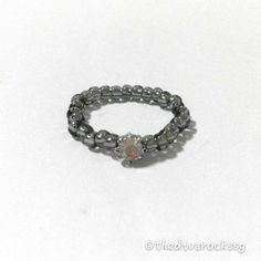 A dainty diamond ring fit for a princess. Grey Japanese seed beads with cubic zirconia diamond centre piece. Stretchable ring bend. Stack a few rings for extra bling!