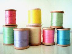 wooden spools of thread