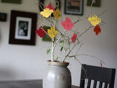 Thanksgiving Tree: Gather branches from outside. Cut out leaf shapes and have kids and adults write what they are thankful for as they arrive for dinner. Punch holes in the leaves and hang them on the branches for a sweet Thanksgiving centerpiece that's also a conversation starter.