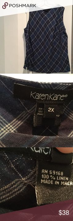 Ladies blue plaid 100 linen tank bias cut like new Ladies blue plaid on a diagonal cut tank 100 linen and very flattering style . Has dark and light blues as well as white. Would be great with jeans as well 2x . Worn once Karen Kane Tops Tank Tops
