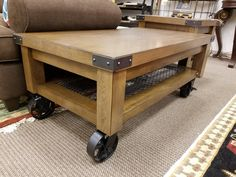 This industrial chic cocktail table is easy to maneuver in the home, only $299.