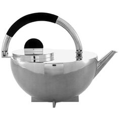 Marianne Brandt (1893-1983, German / MBTK 24 Si Teapot aka Bauhaus Teapot, icon of modern design ... half round body on crossbar foot, w/ off centre lid, D-shape wood knob & bail handle curving from side to top of the pot in design based on circle, square & globe, seen by Bauhaus designers as basic forms of construction, Manufactured by Bauhaus Metal Workshop, 1924, nickel silver & ebony ... part of a set, only one of which is known to exist, available as modern reproduction