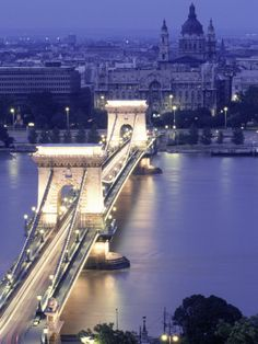 Budapest - I was there in March 2012. We did an evening dinner cruise down the Danube and I passed right under this bridge. Truly breathtaking!