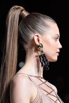 Sleek power ponytails at Balmain Spring 2016. See all the best new beauty looks straight from Paris Fashion Week here: