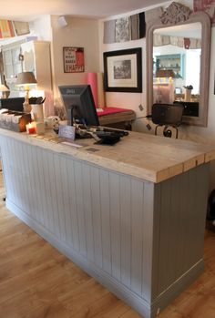 Shop Counter at La Vie en Rose painted in a mix of Louis Blue and Paris Grey.  The countertop is washed in Old White.