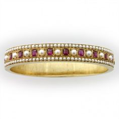 Gold bangle bracelet with rubies and pearls, c. 1860.