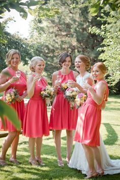 Gorgeous salmon pink bridesmaids dresses // Photo by Madison Rose Photography