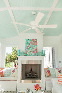 beautiful covered porch with fireplace + blue ceiling