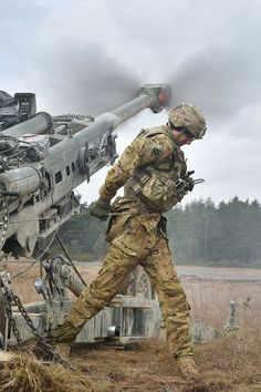 U.S. Army Spc. Vincent Ventarola, assigned to Cobra Battery, Field Artillery Squadron, 2nd Cavalry Regiment, pulls the lanyard on a M777 Howitzer during Exercise Dynamic Front II at the 7th Army Training Command's Grafenwoehr Training Area, Germany.