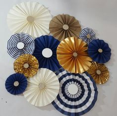 Nautical Striped Navy and Gold Boy Party Set of 12 Rosettes Photo Backdrop ____________________________________________________________________________________________________________ Paper Rosettes are an amazing way to add color and dimension to your decor. Perfect for any event, showers, birthdays, weddings they even dress up a bland wall in a nursery or office. Set of 12 rosettes all different sizes (2-12) (2-10) (2-9) (2-7) (2-6) (2-5) Each rosette is handmade by me and are available…