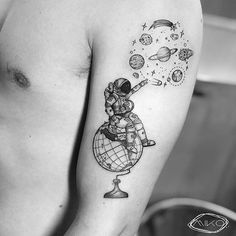 astronaut looking for space planets tattoo