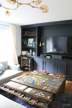 Learn how to create the ultimate game room Create a game room in plain sight with DIY living room built-ins and a DIY coffee table with pullouts Home Made by Carmona Game Room Design, Family Room Design, Game Room Decor, Living Room Decor, Table In Living Room, Living Room Built Ins, Diy Casa, Living Room Remodel, Home And Living