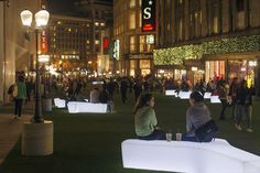 """Winter time in cities often means people retreating into their homes, but the """"Winter Walks SF"""" saw people flocking to this temporary public plaza. The pop-up space was made with simple #LQC materials like astroturf and some seating placed on a previous construction site in Union Sq. Its success has had many visitors proposing permanent pedestrianization of the site. #Placemaking"""