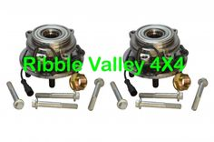 2X TAY100060 - LAND ROVER DISCOVERY 2 TD5 V8 FRONT WHEEL BEARING HUBS WITH ABS SENSORS, NUTS AND BOLTS