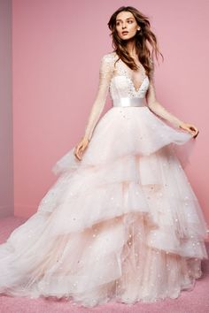 Take a walk down memory lane with Monique Lhuillier and her bridal style evolution throughout the past twenty years..