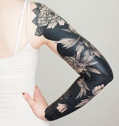 This blossoming black sleeve. | 19 Truly Beautiful Botanical Tattoos
