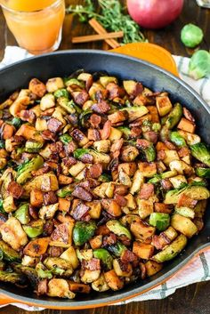 Chicken Apple Sweet Potato Skillet with Bacon and Brussels Sprouts. An easy, healthy one-pan dinner! #wellplated #fall #healthydinner