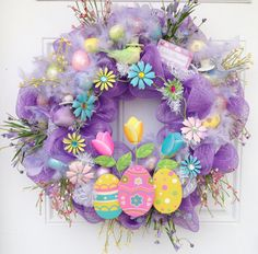 Easter Deco Mesh Wreath with eggs and feathers, cute for Easter or Spring Decor!