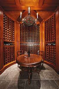 Home wine cellar - I'm going to need one in a couple of months when all my homemade wine is ready to bottle (I'm thinking it's going to be around 60 bottles - 3 5 gallon containers)....maybe Greg can build this for me in the basement....heeheehee.....
