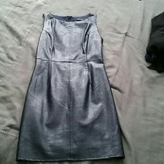 Navy blue, pleather dress Navy blue, pleather cocktail dress. Never worn, only getting rid of because I cant find shoes to match! Incredibly flattering, and has a cloth lining so you wont sweat in the pleather! Wells Grace Dresses Mini