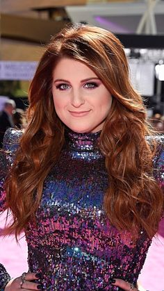 Meghan Trainor at the Billboard Music Awards 2016 with wavy auburn hair.